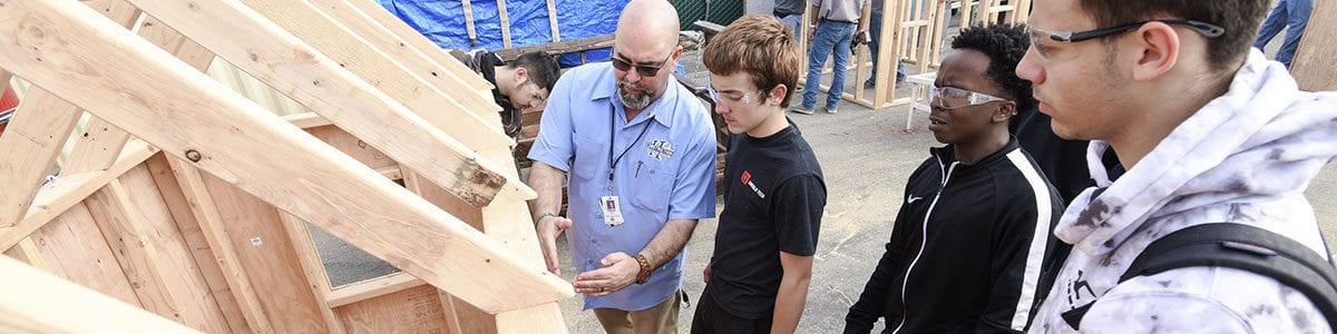 Fresno Unified high school students receive instruction on how to properly build a wooden structure